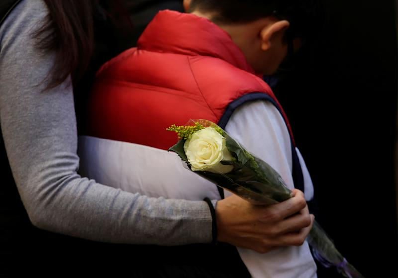 People hug each other during a funeral mass for Maria Assaff, victim of a shooting in Colegio Cervantes private school in Torreon, near Gomez Palacio, Mexico January 12, 2020. REUTERS/Daniel Becerril