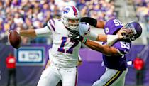 <p>Buffalo Bills quarterback Josh Allen tries to break a tackle by Minnesota Vikings linebacker Anthony Barr (55) during the first half of an NFL football game, Sunday, Sept. 23, 2018, in Minneapolis. (AP Photo/Bruce Kluckhohn) </p>