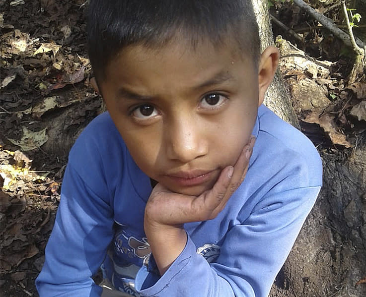 This Dec, 12, 2018 photo provided by Catarina Gomez on Thursday, Dec. 27, 2018, shows her stepbrother Felipe Gomez Alonzo, 8, near her home in Yalambojoch, Guatemala. The 8-year-old boy died in U.S. custody at a New Mexico hospital on Christmas Eve after suffering a cough, vomiting and fever, authorities said. The cause is under investigation. (Catarina Gomez via AP)