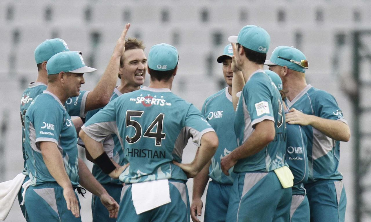 Players of Brisbane Heat celebrate after fall of a wicket during the CLT20 match between Titans and Brisbane Heat at Mohali stadium, Chandigarh on Sept. 24, 2013. (Photo: IANS)