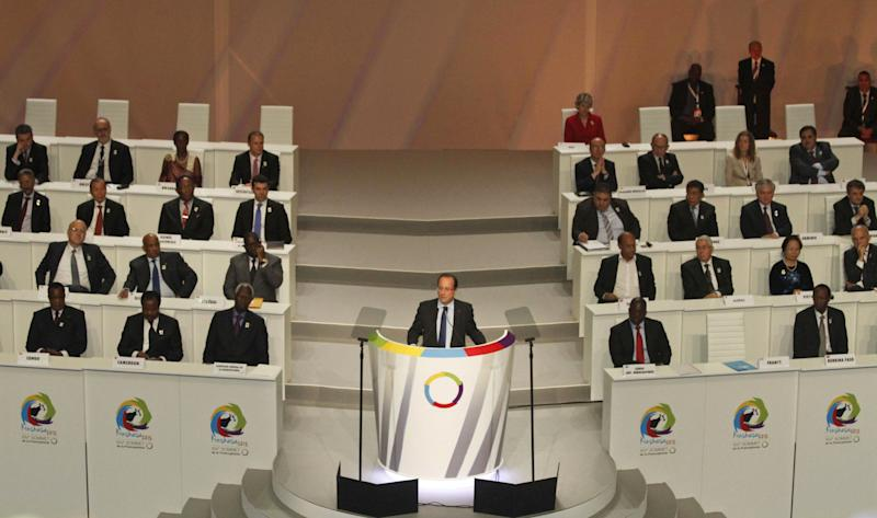 French President Francois Hollande speaks during the opening session of the Francophonie Summit, in Kinshasa, Congo, Saturday, Oct. 13, 2012. Hollande is taking part in a summit of French-speaking countries, after months of controversy surrounding his visit to the vast Central African nation. He initially threatened not to attend but ultimately confirmed his participation in July, saying he wants to break away from the traditional paternalistic ways of France toward Africa. (AP Photo/John Bompengo)