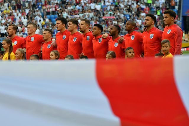 <p>The England team sing the national anthem </p>