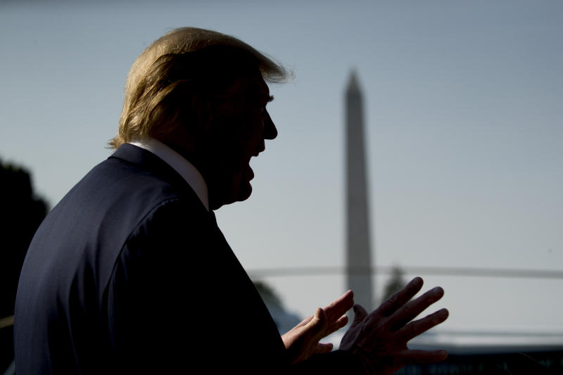 President Donald Trump speaks to members of the media on the South Lawn of the White House in Washington, Wednesday, Aug. 7, 2019, before boarding Marine One for a short trip to Andrews Air Force Base, Md., and then on to Dayton, Ohio, and El Paso, Texas, in the afternoon to praise first responders and console family members and survivors from two recent mass shootings. (AP Photo/Andrew Harnik)