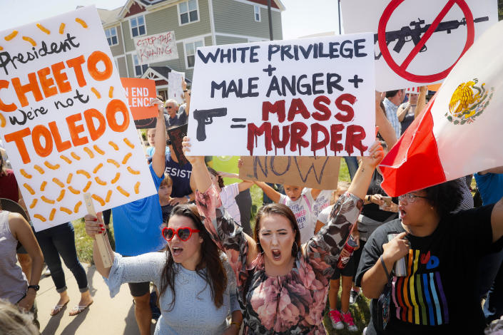 Demonstrators chant as they protest the arrival of President Donald Trump outside Miami Valley Hospital after a mass shooting that occurred in the Oregon District early Sunday morning, Aug. 7, 2019, in Dayton. (Photo: John Minchillo/AP)
