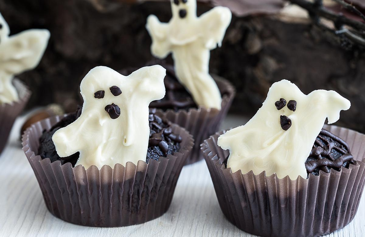 "<p>White chocolate is a delicious treat no matter the day, so this party favor is sure to be a hit. Simply melt the chocolate and use a teaspoon to scoop and spread it in a swooping ""ghost shape"" on a sheet of wax paper. Use <a href=""https://www.thedailymeal.com/cook/crazy-origin-chocolate-chips?referrer=yahoo&category=beauty_food&include_utm=1&utm_medium=referral&utm_source=yahoo&utm_campaign=feed"">chocolate chips</a> as eyes, and refrigerate for 20 to 30 minutes. Children will have a blast creating this sweet snack, so get the entire family involved.</p>"