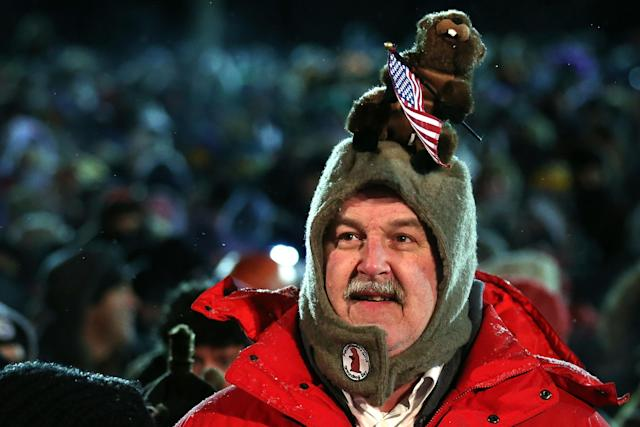 PUNXSUTAWNEY, PA - FEBRUARY 02: A man waits for the Punxsutawney Phil to come out from his winter den during the 127th Groundhog Day Celebration at Gobbler's Knob on February 2, 2013 in Punxsutawney, Pennsylvania. The Punxsutawney 'Inner Circle' claimed that there were about 35,000 people gathered at the event to watch Phil's annual forecast. (Photo by Alex Wong/Getty Images)