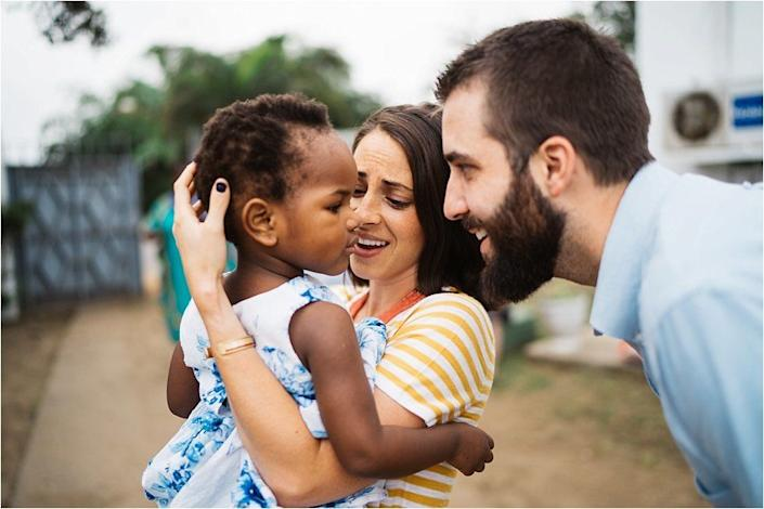 """""""The Shaws waited a long time for this moment, four years to be exact. Their adoption journey landed them with<a href=""""https://www.mwanavillages.org/"""" target=""""_blank"""">Mwana Villages</a>20 months ago when they first found out about their daughter. This is theirjourney to their daughter.Adoption can be hard and broken, and the meeting moments aren't the cure all, but they sure are sweet. It was a special moment getting to witness the redemption that was brought through this long wait.""""<br /><br /><i>Photo byAllie Chandlerof The Archibald Project, an orphan care advocacy organization using media to eliminate the orphan crisis, one story at a time. You can follow<a href=""""http://www.thearchibaldproject.com"""" target=""""_blank"""">The Archibald Project</a>on<a href=""""https://www.instagram.com/thearchibaldproject/"""" target=""""_blank"""">Instagram</a>,<a href=""""https://www.facebook.com/TheArchibaldProject/"""" target=""""_blank"""">Facebook</a>and<a href=""""https://www.youtube.com/channel/UCM32JmlLuOH8PaeuL59znbQ"""" target=""""_blank"""">YouTube</a>.</i>"""
