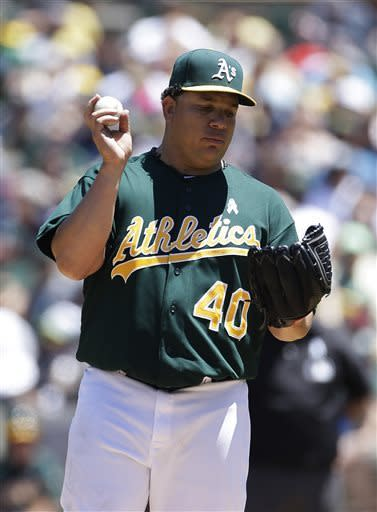 Oakland Athletics starting pitcher Bartolo Colon stands on the mounds after the Seattle Mariners scored two runs on a single by Endy Chavez during the second inning of their baseball game Sunday, June 16, 2013 in Oakland, Calif. (AP Photo/Eric Risberg)