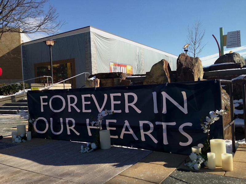 A makeshift memorial sits outside the Mall of Columbia, Md., Monday, Jan. 27, 2014, after a weekend shooting that left three people dead, including the gunman, is set to reopen with increased security. (AP Photo/Jessica Gresko