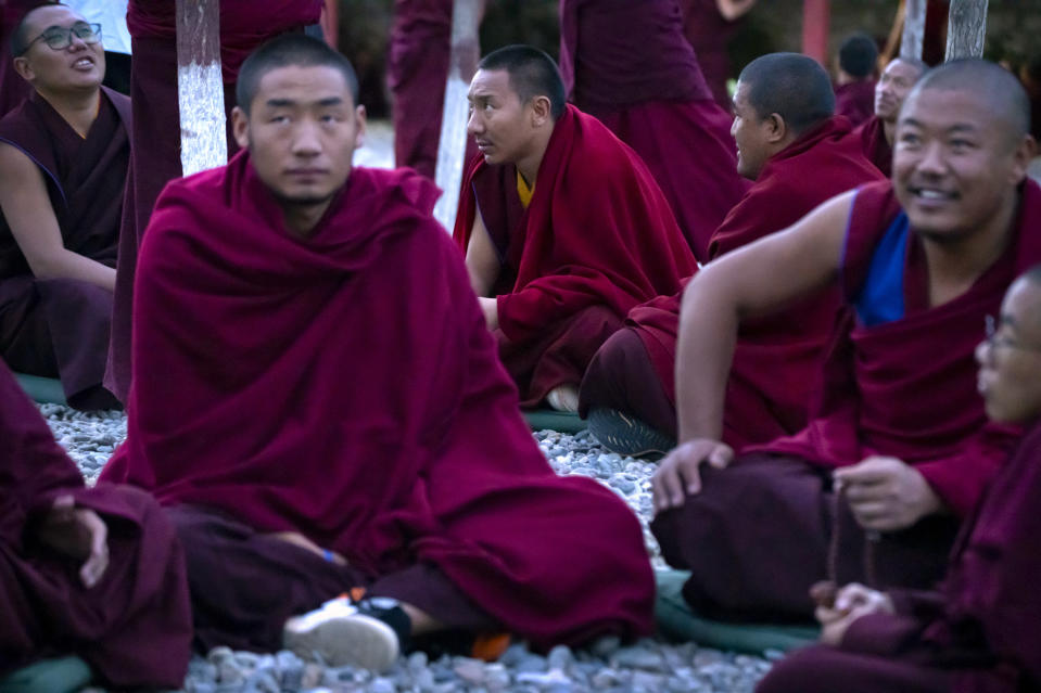 Monks in crimson robes hold debate sessions in an outdoor area at the Tibetan Buddhist College near Lhasa in western China's Tibet Autonomous Region, as seen during a rare government-led tour of the region for foreign journalists, Monday, May 31, 2021. Long defined by its Buddhist culture, Tibet is facing a push for assimilation and political orthodoxy under China's ruling Communist Party. (AP Photo/Mark Schiefelbein)