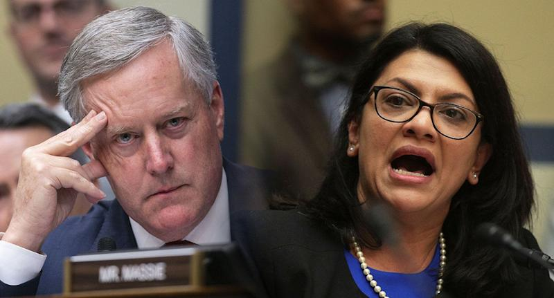 Representative Mark Meadows, left, a Republican from North Carolina, listens as comments made by Representative Rashida Tlaib, Democrat from Michigan are reviewed a House Oversight Comittee hearing with Michael Cohen, former personal lawyer to U.S. President Donald Trump, not pictured, in Washington, D.C., on Wednesday, Feb. 27, 2019. (Photos: Al Drago/Bloomberg via Getty Images - Alex Wong/Getty Images)