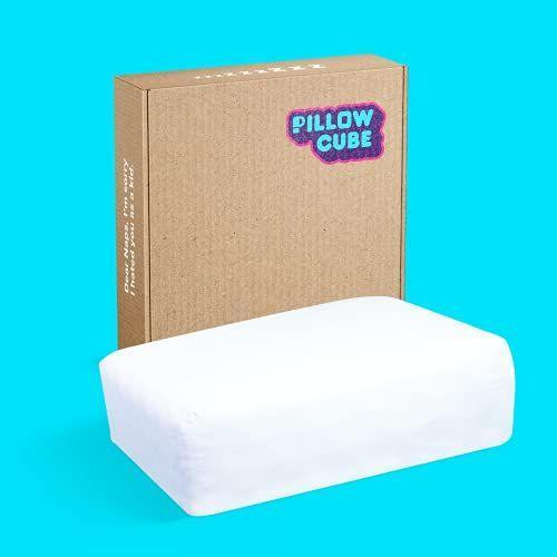 """<p><strong>PILLOW CUBE</strong></p><p>amazon.com</p><p><strong>$99.00</strong></p><p><a href=""""https://www.amazon.com/dp/B096TDRGXC?tag=syn-yahoo-20&ascsubtag=%5Bartid%7C2089.g.27269473%5Bsrc%7Cyahoo-us"""" rel=""""nofollow noopener"""" target=""""_blank"""" data-ylk=""""slk:Shop Now"""" class=""""link rapid-noclick-resp"""">Shop Now</a></p><p>Side sleepers, rejoice! If you're used to waking up in the morning with neck pain, this pillow should help alleviate it. Just as the name implies, this cube-shaped pillow raises your head up, so your neck is aligned with your spine while you sleep. <a href=""""https://www.bestproducts.com/home/a36620620/pillow-cube-review/"""" rel=""""nofollow noopener"""" target=""""_blank"""" data-ylk=""""slk:We're big fans."""" class=""""link rapid-noclick-resp"""">We're big fans.</a></p>"""