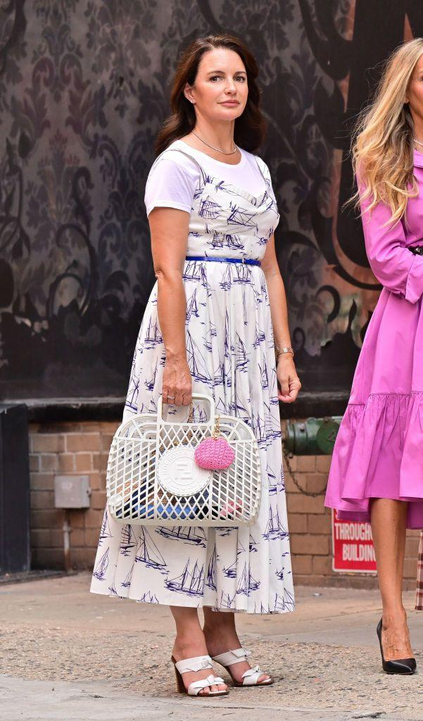 <p>Davis took to the streets in an Emilia Wickstead Elita printed cotton poplin midi dress, along with Alexandre Birman Clarita padded leather block-heel sandals, a Fendi basket logo-embossed tote bag, and a tennis necklace by Meira T Jewelry. </p>
