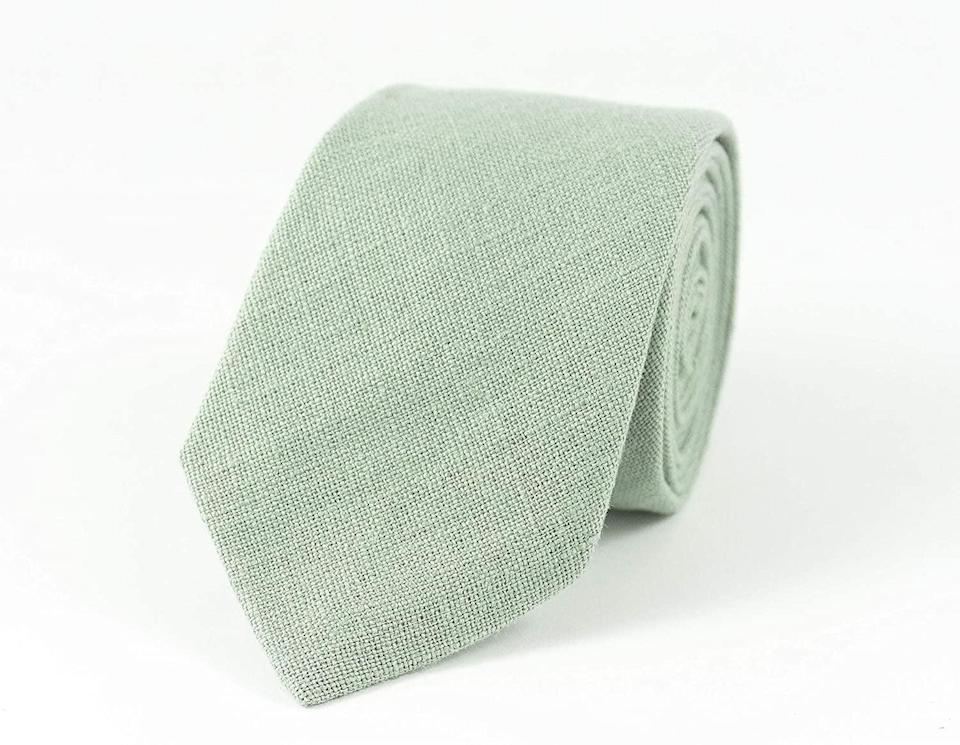 <p>If they wear ties to the office get them this gorgeous <span>Light Dusty Sage Green Linen Necktie</span> ($39). It'll brighten up their wardrobe, especially if they lean towards darker hues. </p>