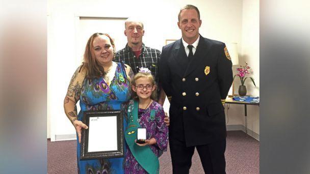 PHOTO: Alexandria, Indiana, Fire Chief Brian Cuneo poses with Melina Lakey, 9, and her parents, Ashley McCollum-Lakey and Jeff Lakey. (Girl Scouts of Central Indiana)