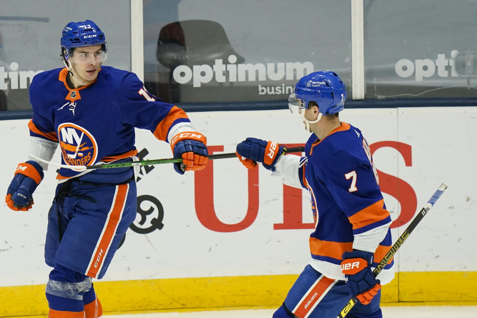 New York Islanders' Mathew Barzal (13) celebrates with Jordan Eberle (7) after scoring a goal during the third period of an NHL hockey game against the New Jersey Devils Saturday, May 8, 2021, in Uniondale, N.Y. The Islanders won 5-1. (AP Photo/Frank Franklin II)