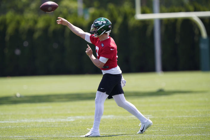 New York Jets quarterback Zach Wilson passes during NFL football practice Thursday, May 27, 2021, in Florham Park, N.J. (AP Photo/Kathy Willens)