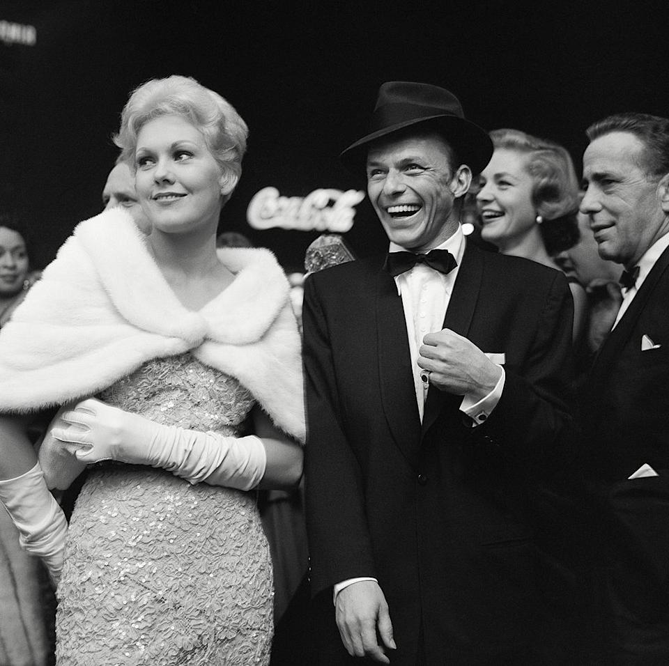 Kim Novak and Frank Sinatra attend a movie premiere with Lauren Bacall and Humphrey Bogart on Oct. 10, 1955, in Los Angeles. (Photo: Earl leaf/Michael Ochs Archives/Getty Images)