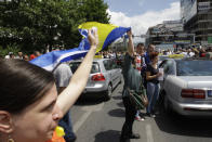 """Bosnian people demonstrate in front of Bosnian parliament building in Sarajevo,wave a Bosnian flag, on Tuesday, June 11, 2013. Bosnia's """"baby revolution"""" began last week as a small protest of parents pushing strollers to parliament to demand a new law be passed so their newborns could get national identity numbers, needed to acquire passports and other documents. Now, the anti-government demonstrations appear to be transcending ethnic boundaries and creating a sense of harmony rarely seen in a country where hatreds have endured since the end of a bloody war in the 1990s. (AP Photo/Amel Emric)"""