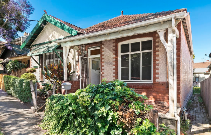 Pictured is the front of the brick home at 80 Watkin Street, Newtown.