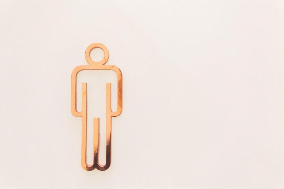 Men toilet signs on a white wall