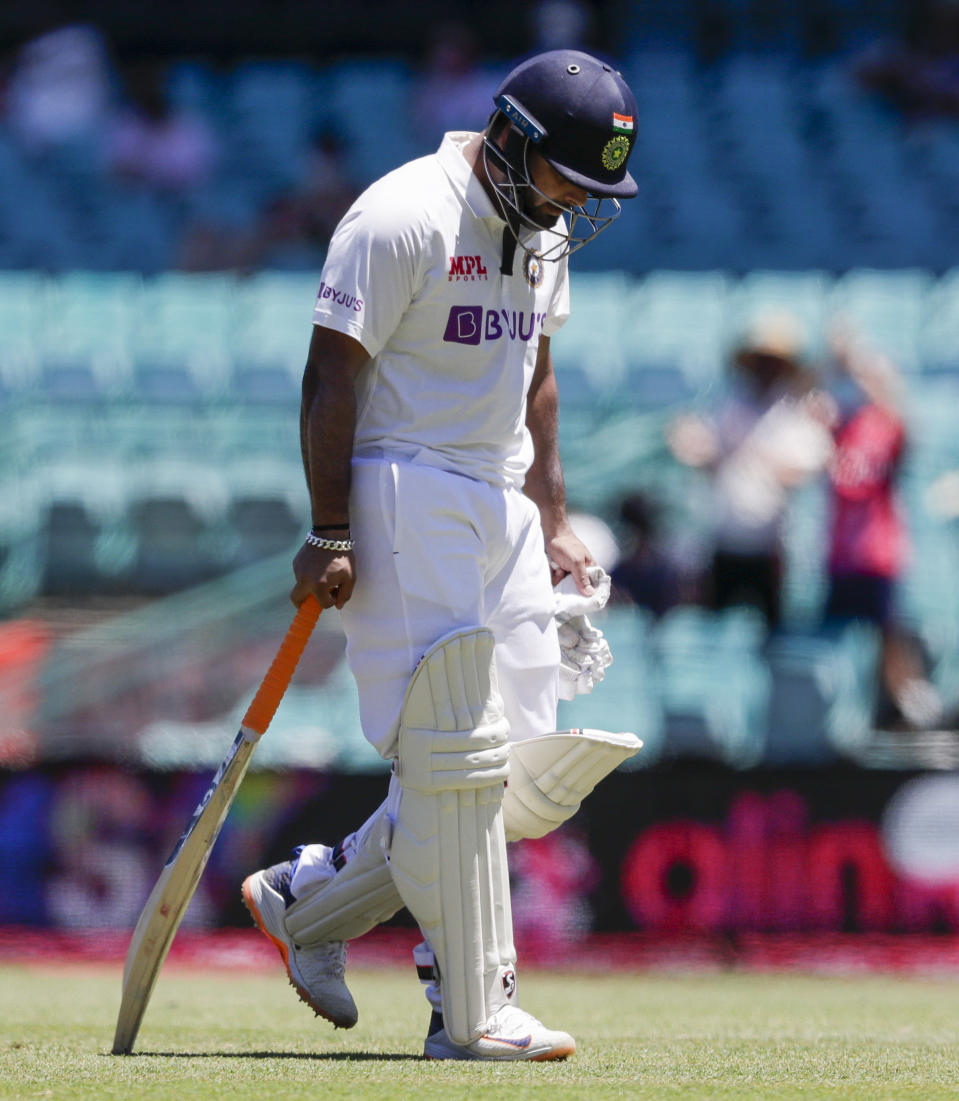 India's Rishabh Pant reacts as he leaves the field after he was dismissed on 97 during play on the final day of the third cricket test between India and Australia at the Sydney Cricket Ground, Sydney, Australia, Monday, Jan. 11, 2021. (AP Photo/Rick Rycroft)