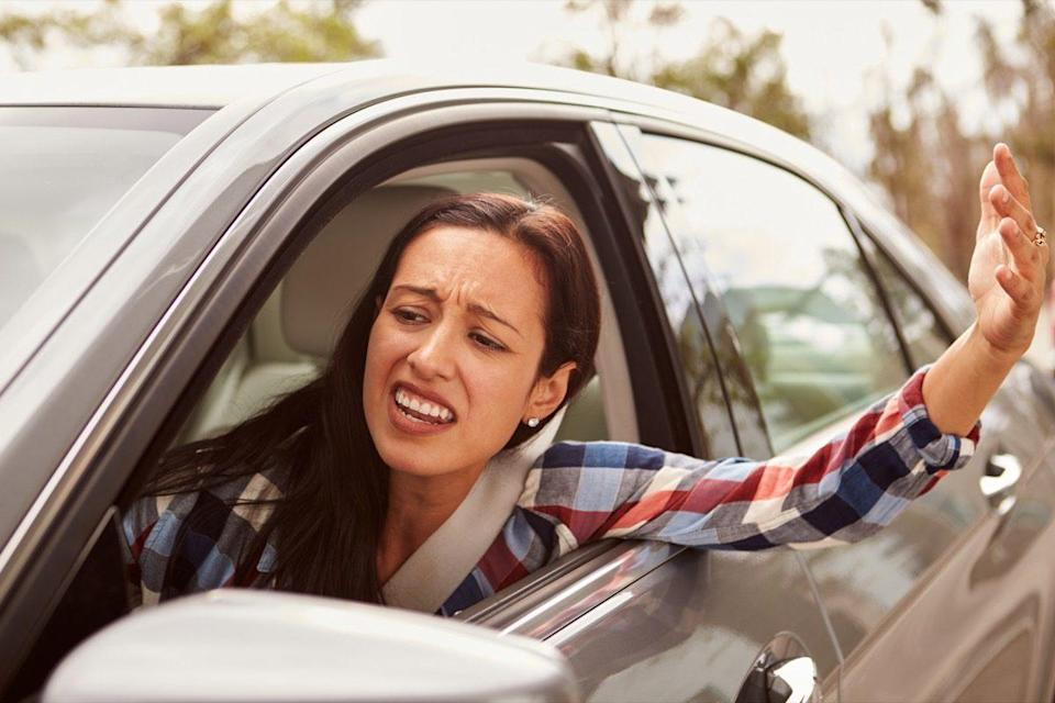 Frustrated Hispanic female driver in a car