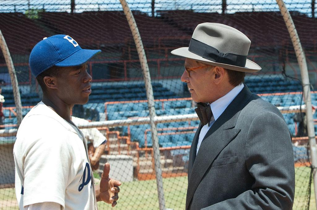 "Chadwick Boseman and Harrison Ford in Warner Bros. Pictures' ""42"" - 2013"