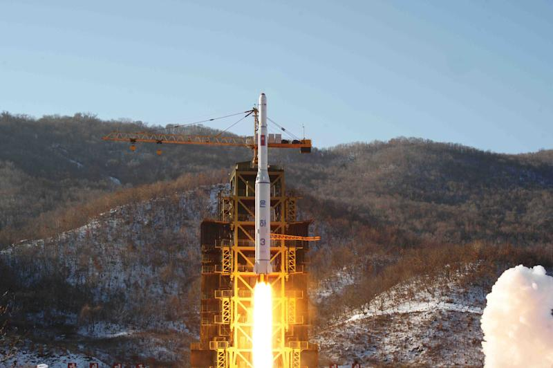 FILE - In this Dec. 12, 2012 file photo released by Korean Central News Agency, North Korea's Unha-3 rocket lifts off from the Sohae launch pad in Tongchang-ri, North Korea. Though it remains a highly unlikely scenario, Japanese officials have long feared that if North Korea ever decides to play its nuclear card it has not only the means but several potential motives for launching an attack on Tokyo or major U.S. military installations on Japan's main island. And while a conventional missile attack is far more likely, Tokyo is taking North Korea's nuclear rhetoric seriously. (AP Photo/KCNA, File)