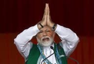 """FILE- In this March 30, 2019 file photo, Indian Prime Minister Narendra Modi gestures as he speaks during an election campaign rally of his Bharatiya Janata Party (BJP) in Along, Arunachal Pradesh, India. Modi on Sunday apologized to the country's public for imposing the ongoing world's largest lockdown for three weeks, calling it harsh but """"needed to win"""" the battle against coronavirus pandemic. (AP Photo/Anupam Nath, File)"""