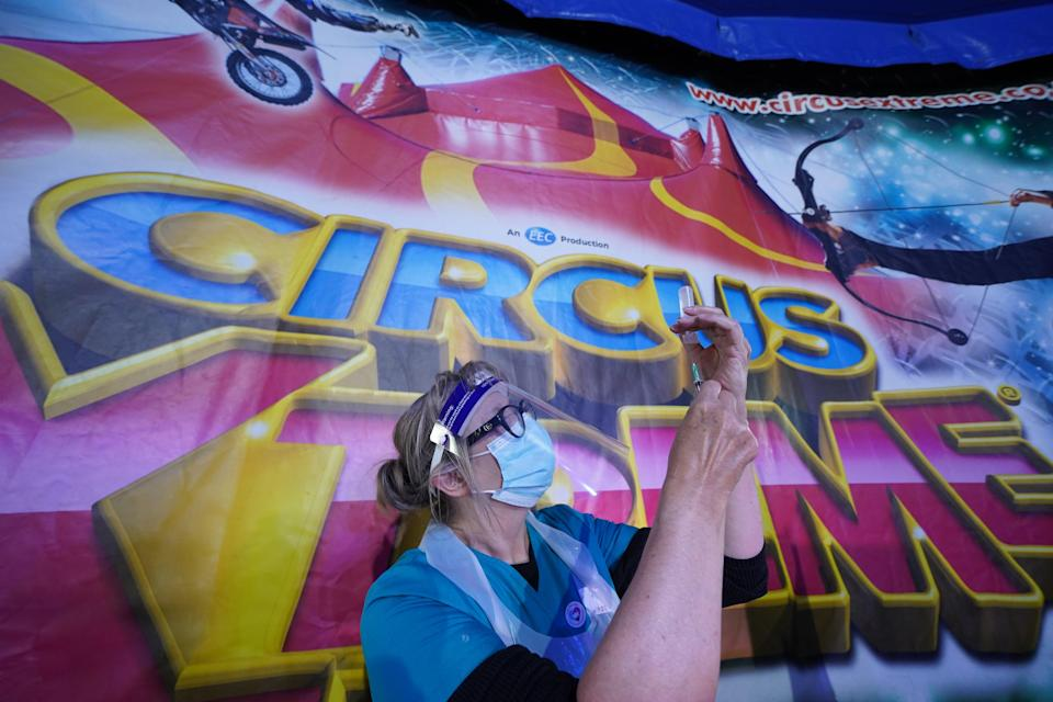 A doctor prepares a syringe at a pop-up Covid-19 vaccination clinic in the marquee of Circus Extreme in Halifax (Owen Humphreys/PA) (PA Wire)