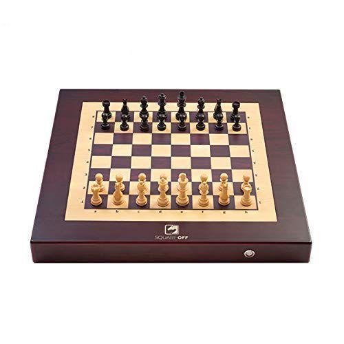 """<h3>The Three-Moves-Ahead Dad</h3><p>If you can't be there to play a round of chess with your dad in-person, this electronic chess board lets you challenge each other long-distance. Your remote opponent's pieces move automatically, gliding across the board — and if you're not quite matched to your dad's skill set, he can challenge 23 million other players worldwide (or play against the built-in AI).</p><br><br><strong>SquareOff</strong> Electronic Chess Set, $389, available at <a href=""""https://www.amazon.com/Square-Off-automated-opponents-Against/dp/B07DWCMTPH"""" rel=""""nofollow noopener"""" target=""""_blank"""" data-ylk=""""slk:Amazon"""" class=""""link rapid-noclick-resp"""">Amazon</a>"""