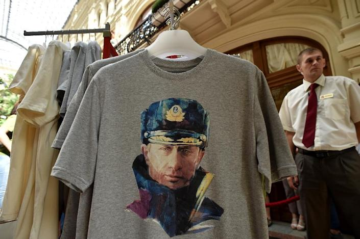T-shirts with portraits of Russia's President Vladimir Putin hang in a shop in central Moscow (AFP Photo/Kirill Kudryavtsev)