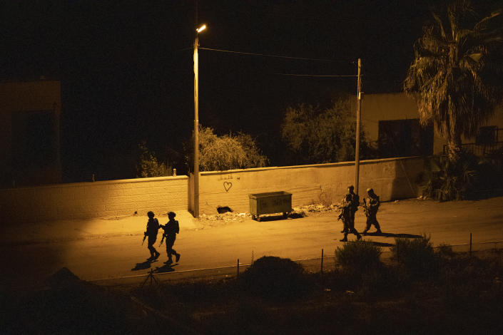 An Israeli army unit prepares to demolish the house of the Palestinian American Muntasser Shalaby in the West Bank village of Turmus Ayya, north of Ramallah, Thursday, July 8, 2021. Israeli forces on Thursday demolished the Shalaby family home with controlled explosives after being accused of being involved in a deadly attack on Israelis in the West Bank in May. (AP Photo/Nasser Nasser)