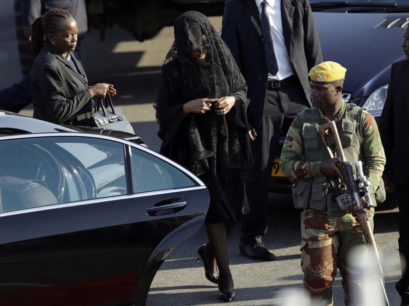Grace Mugabe, second from left, wife of former President Robert Mugabe, attends the arrival ceremony of his remains at Robert Gabriel Mugabe International Airport in Harare, Zimbabwe, Wednesday, Sept. 11, 2019. Mugabe died Friday in a Singapore hospital at age 95. (AP Photo/Themba Hadebe)