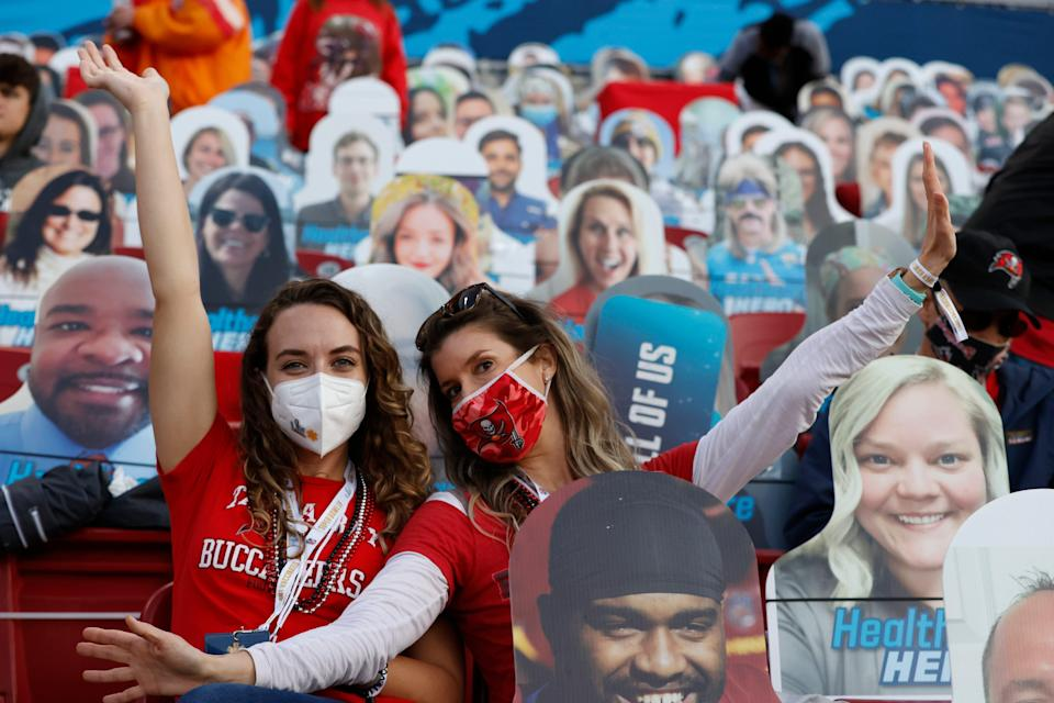 Fans sit amongst cardboard cutouts of fans before Super Bowl LV between the Kansas City Chiefs and the Tampa Bay Buccaneers at Raymond James Stadium.