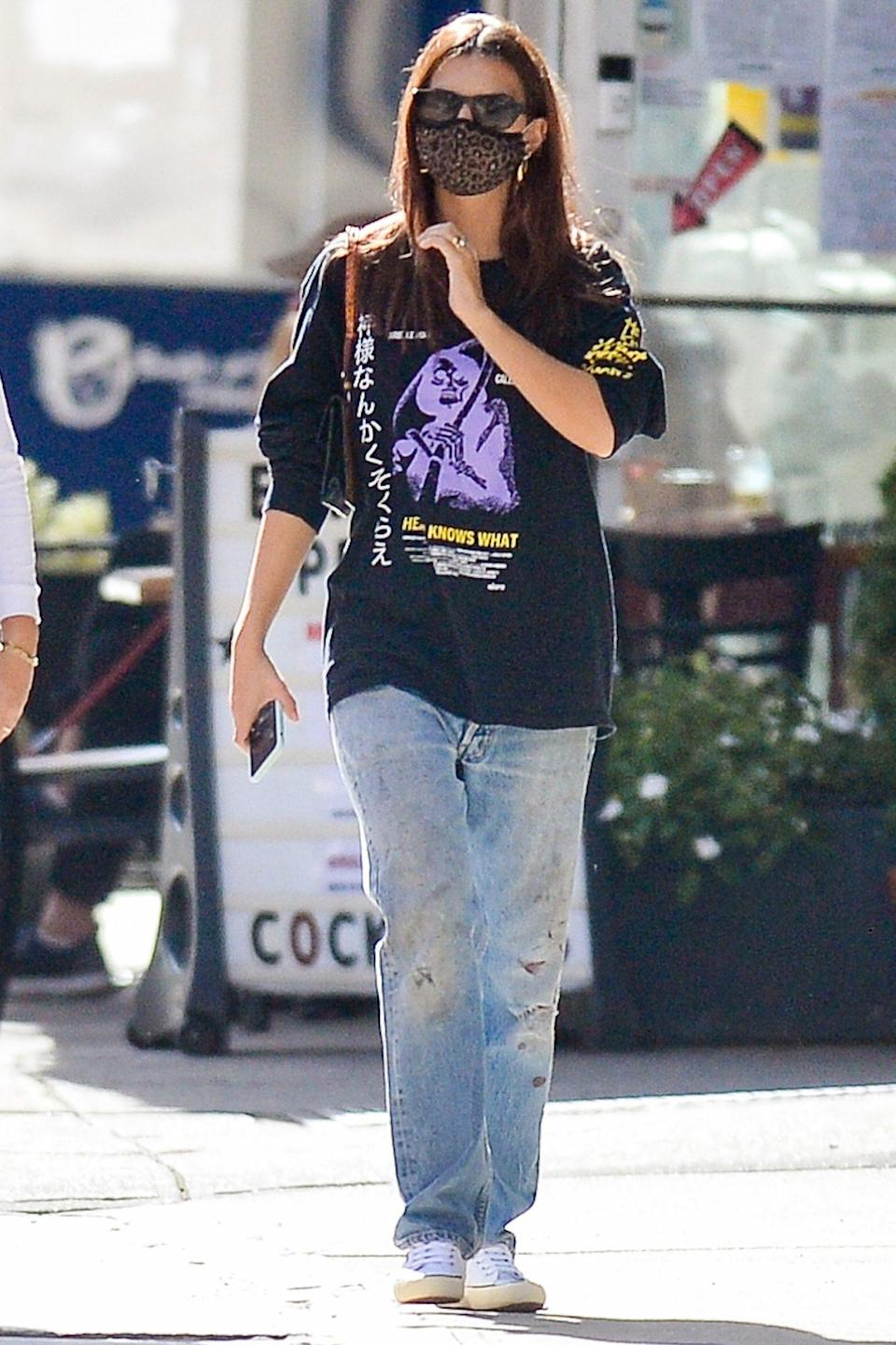 <p>Emily Ratajkowski wears a shirt from her husband's 2014 film <em>Heaven Knows What </em>while out and about in N.Y.C. on Thursday. </p>