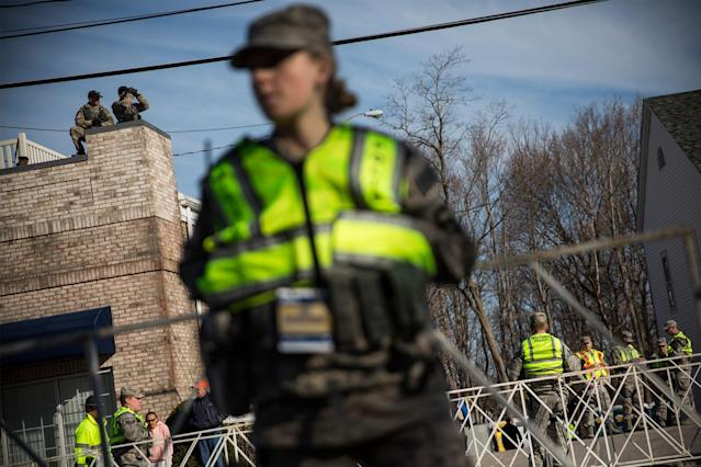HOPKINGTON, MA - APRIL 21: A Military Police officer stands guard prior to the start of the Boston Marathon on April 21, 2014 in Hopkington, Massachusetts. Today marks the 118th Boston Marathon; security presence has been increased this year, due to two bombs that were detonated at the finish line last year, killing three people and injuring more than 260 others. (Photo by Andrew Burton/Getty Images)