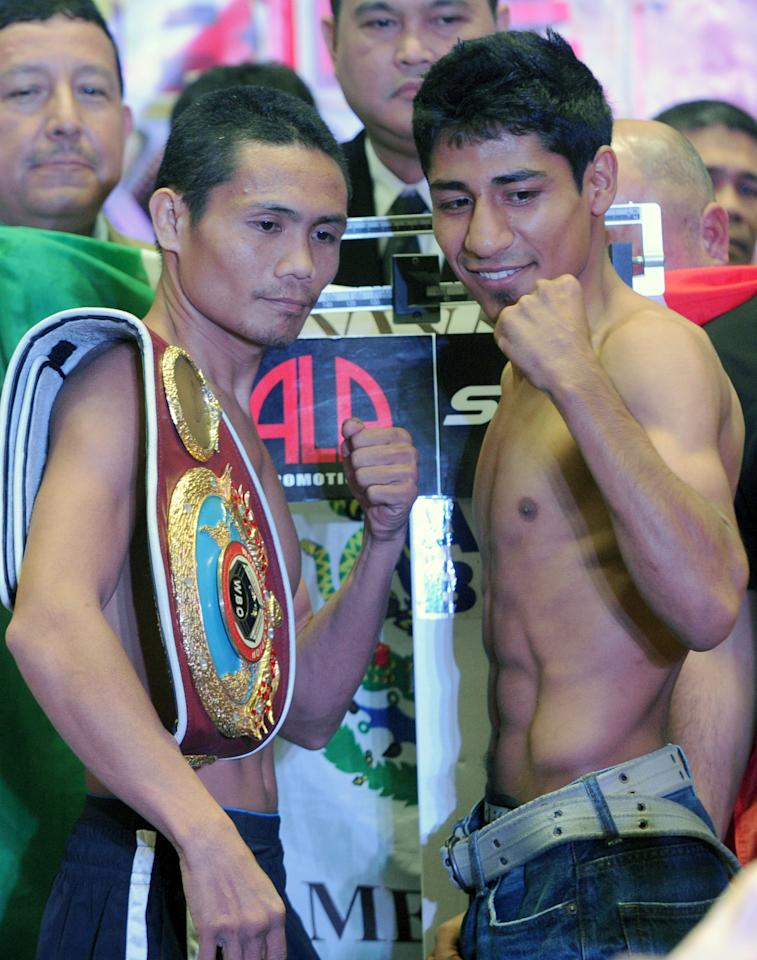 World Boxing Organisation light-flyweight champion Donnie Nietes (L) of the Philippines faces off with Mexican challenger Felipe Salguero (R) at the official weigh-in located at Manila on June 1, 2012.  Nietes will seek to defend his crown on home ground on June 2.  AFP PHOTO / Jay DIRECTOJAY DIRECTO/AFP/GettyImages