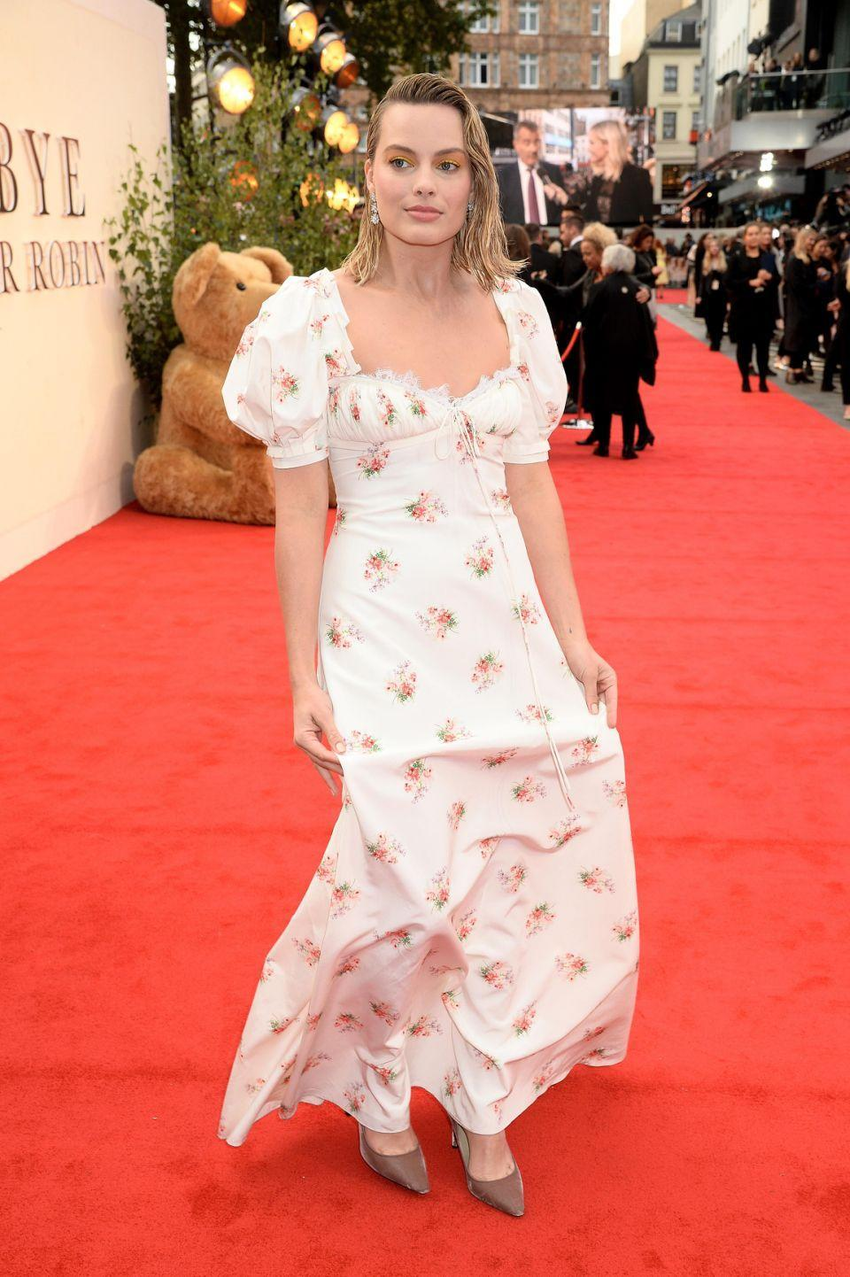 The dress is a departure from Margot Robbie's usual figure-hugging numbers. (Photo: Getty Images)