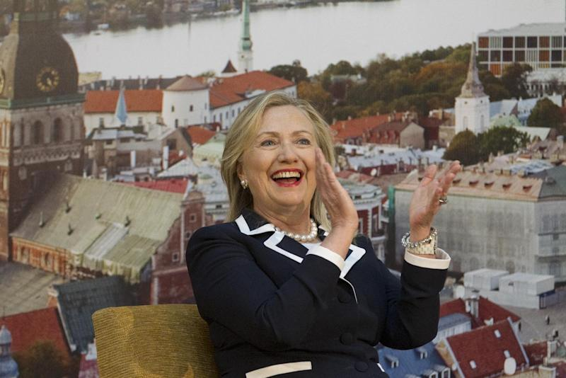 U.S. Secretary of State Hillary Rodham Clinton applauds during interview with Latvian youth at the University of Latvia, Thursday, June 28, 2012, in Riga, Latvia. (AP Photo/Haraz N. Ghanbari, Pool)
