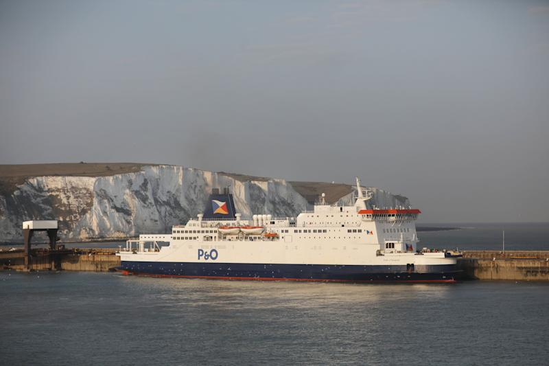 The white cliffs of Dover sit beyond the Pride of Burgundy, a cross-Channel passenger and freight ferry operated by P&O Ferries Ltd, in the Port of Dover Ltd., in Dover, U.K., on Monday, April 1, 2019. After seven hours of Brexit talks with her cabinet ministers, U.K. Prime Minister Theresa May said the U.K. will need an extra delay beyond next weeks potential cliff-edge deadline of April 12 to resolve the crisis. Photographer: Chris Ratcliffe/Bloomberg via Getty Images
