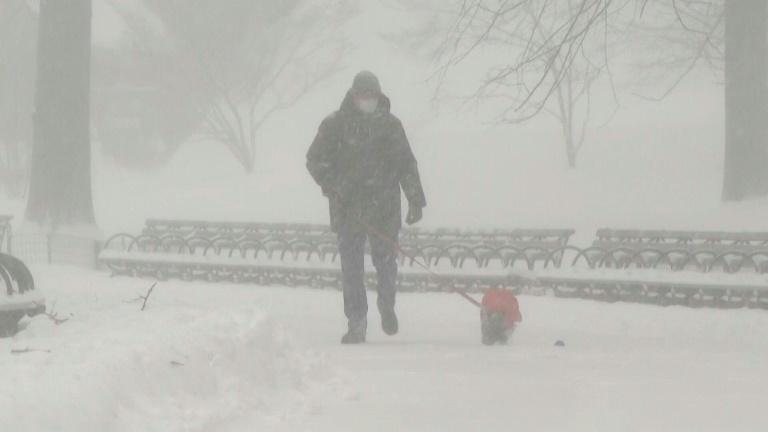 New Yorkers brave the weather as city blanketed by snow