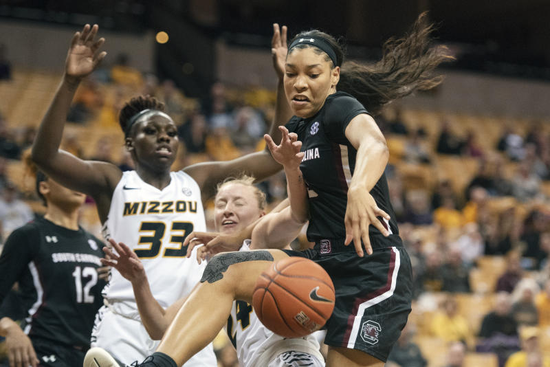South Carolina's Victaria Saxton, right, fights off Missouri's Jordan Chavis, center, and Aijha Blackwell, left, for a rebound during the first half of an NCAA college basketball game Thursday, Jan. 16, 2020, in Columbia, Mo. (AP Photo/L.G. Patterson)