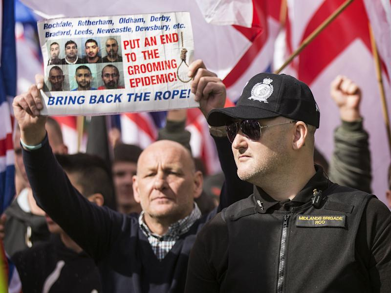 A demonstrator with 'Bring back the rope!' sign during a Britain First Rotherham demonstration in 2015: Rex Features