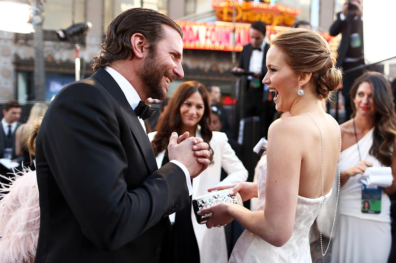 Bradley Cooper (L) and Jennifer Lawrence arrive at the Oscars held at Hollywood & Highland Center on February 24, 2013 in Hollywood, California.  (Photo by Christopher Polk/Getty Images)