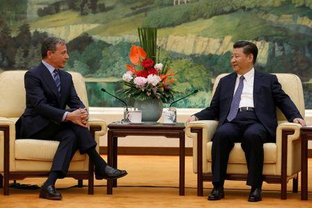China's President Xi Jinping (R) talks with Chief Executive Officer of Disney Bob Iger as they meet at the Great Hall of the People in Beijing, China, May 5, 2016. REUTERS/Kim Kyung-Hoon