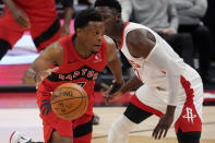 Toronto Raptors guard Kyle Lowry (7) loses the ball as he attempts to drive past Houston Rockets guard Victor Oladipo during the second half of an NBA basketball game Friday, Feb. 26, 2021, in Tampa, Fla. (AP Photo/Chris O'Meara)