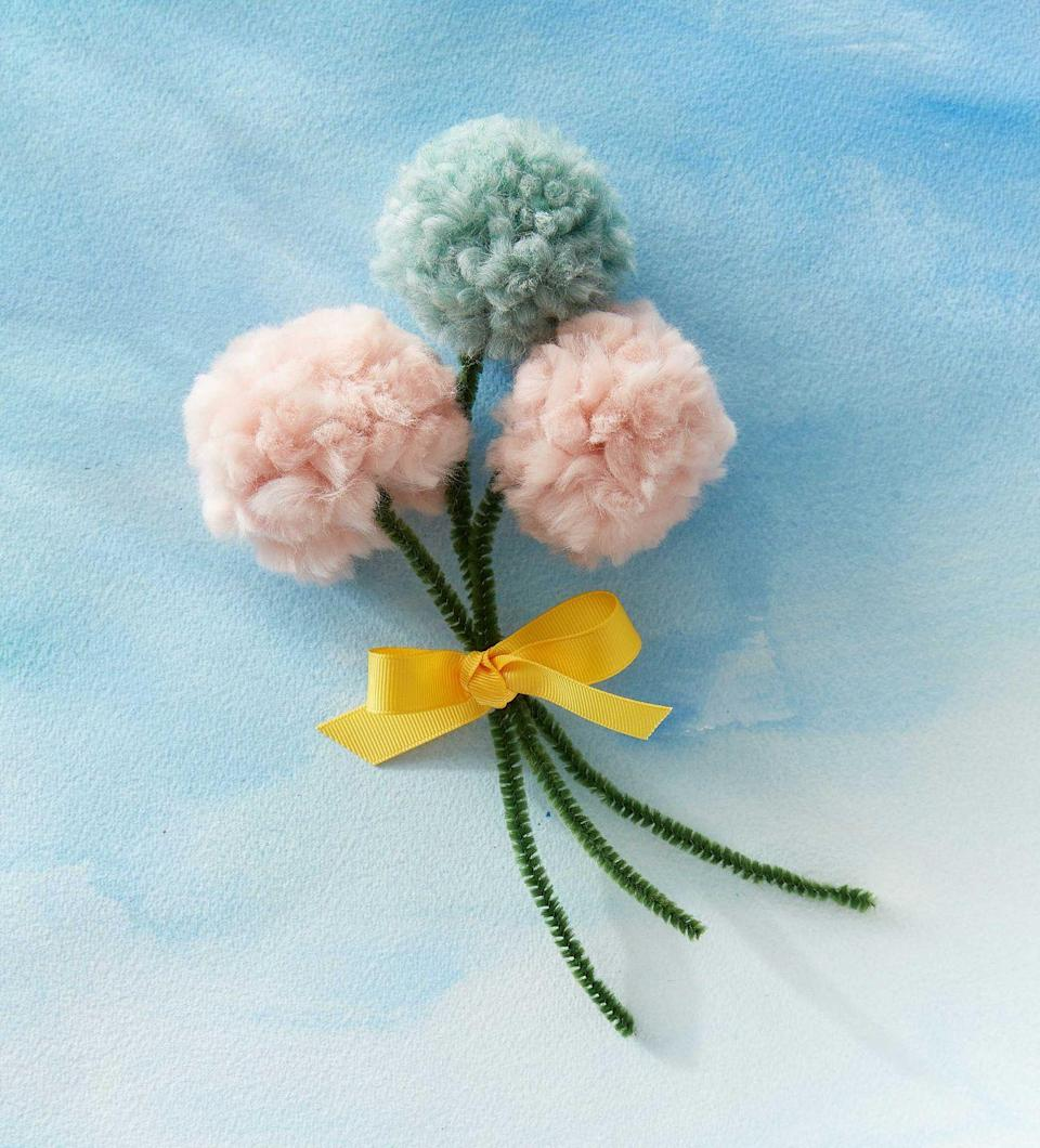 """<p>Kids can make mom an evergreen yarn bouquet to symbolize their everlasting love. <strong><br></strong></p><p><strong>To make</strong>: start by placing a green pipe cleaner parallel with the tines of a fork so that it extends 3 inches above the tines. Wrap yarn perpendicularly around all the tines. Fold the 3-inch section of pipe cleaner down over the yarn, slide everything off the fork, and wrap the two pieces of pipe cleaner together. Carefully cut the wrapped yarn and trim any scraggly ends. Repeat as desired. Wrap stems together with a length of ribbon.</p><p><a class=""""link rapid-noclick-resp"""" href=""""https://www.amazon.com/Creativity-Street-Chenille-Cleaners-100-Piece/dp/B000RY70N4/?tag=syn-yahoo-20&ascsubtag=%5Bartid%7C10050.g.2357%5Bsrc%7Cyahoo-us"""" rel=""""nofollow noopener"""" target=""""_blank"""" data-ylk=""""slk:SHOP PIPE CLEANERS"""">SHOP PIPE CLEANERS</a></p>"""