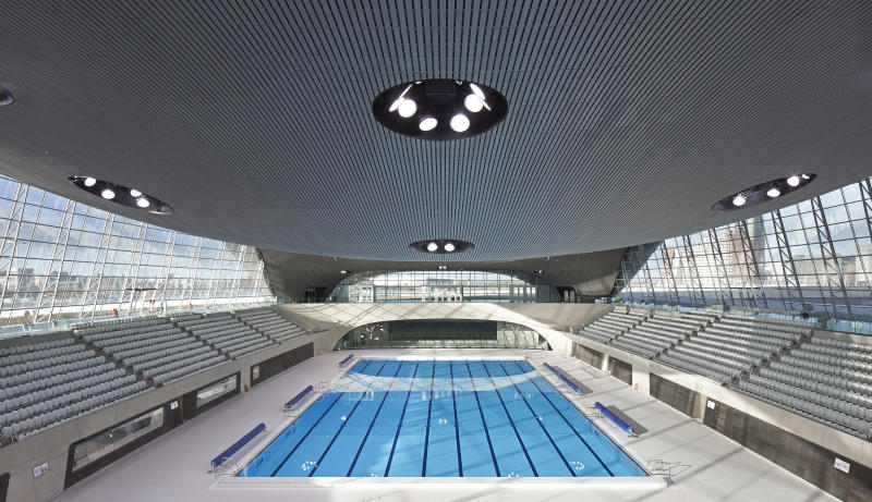 London Aquatics Centre, after the 2012 Games, London, United Kingdom. Architect: Zaha Hadid Architects, 2011. Overall view of competition pool and spectator stands. (Photo by: Hufton+Crow/View Pictures/Universal Images Group via Getty Images)